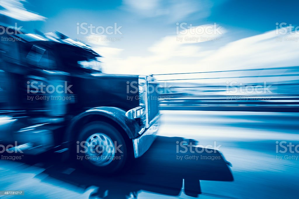 Fast Truck on Highway, Blue Toned stock photo