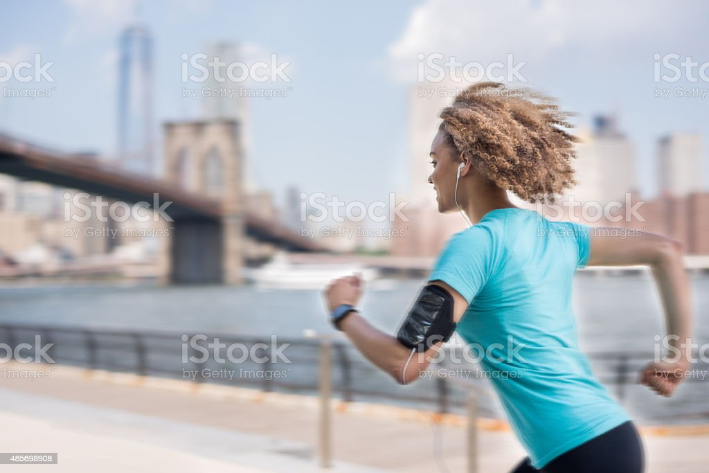 Fast woman running in New York stock photo