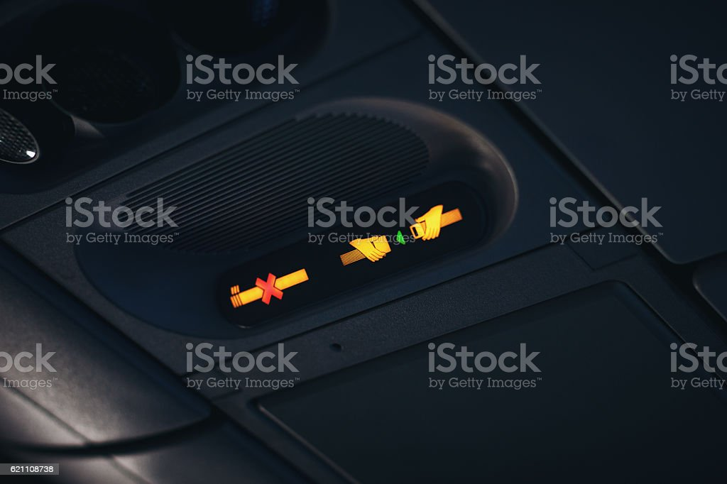 Fasten seat belt and no smoking signs stock photo