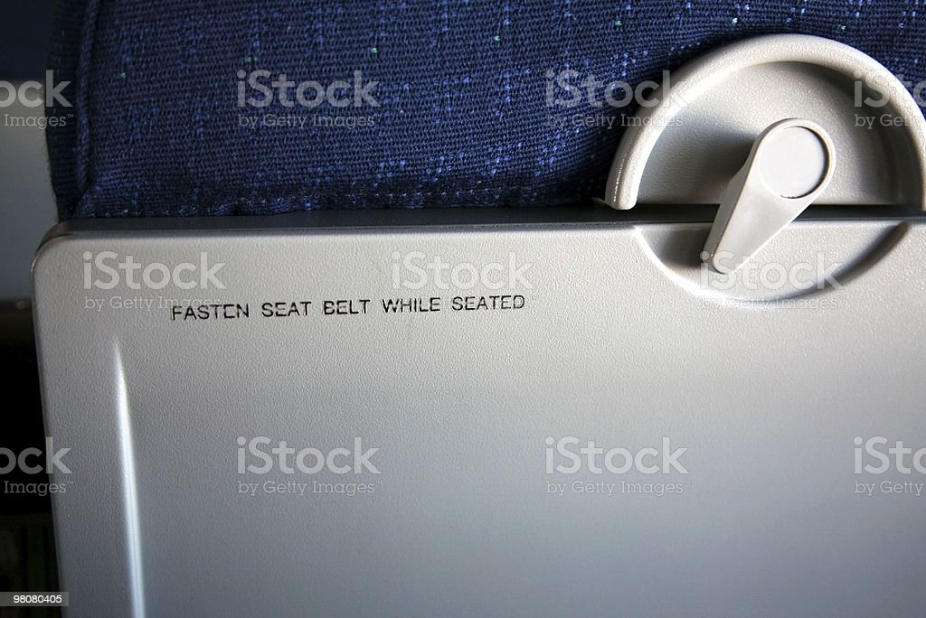 Fasten Seat Belt While Seated royalty-free stock photo