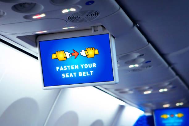 系好你的安全帶警告在飛機 - 亂流 個照片及圖片檔