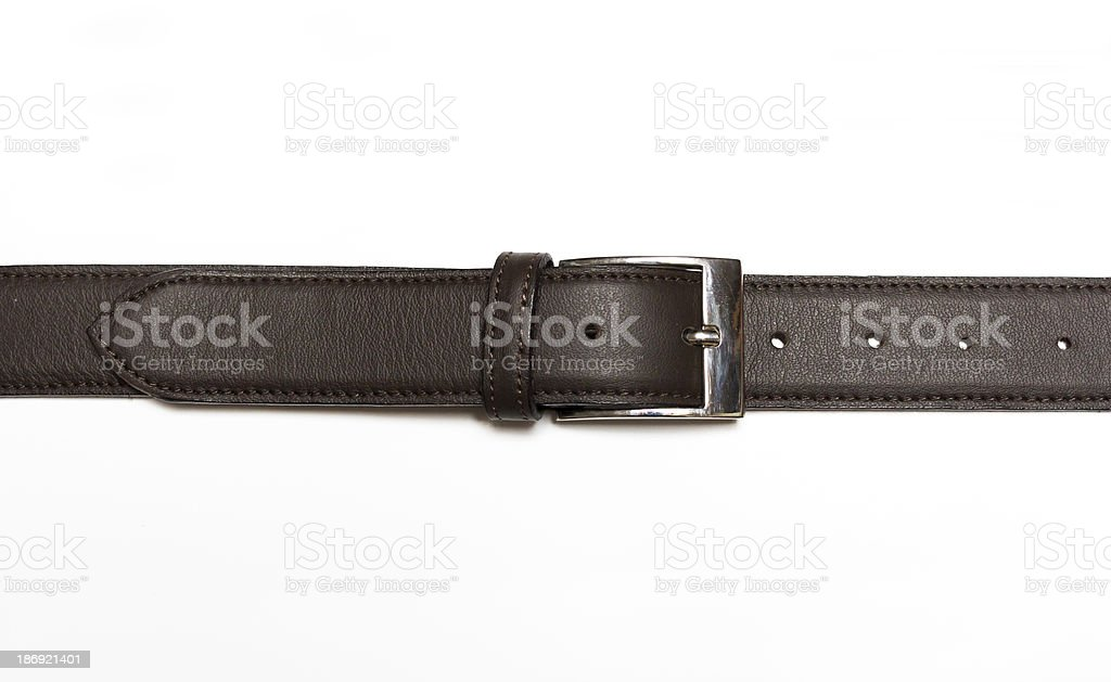 Fastened brown leather belt stock photo
