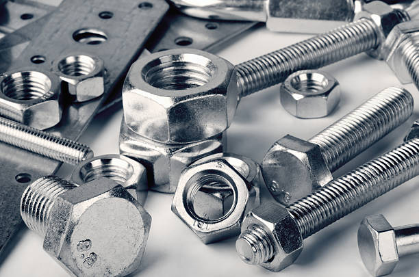 Fasteners Close-up of various steel nuts and bolts bolt fastener stock pictures, royalty-free photos & images