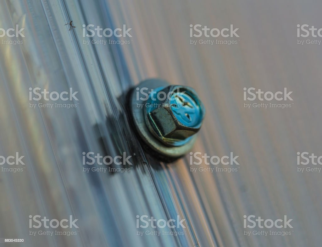 Fasteners plastic organic glass stock photo