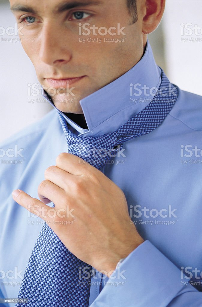 Fastening a tie royalty-free stock photo