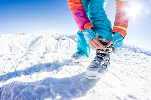 Fastening the ski boots