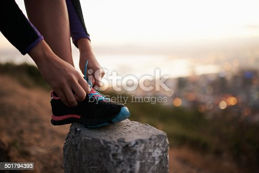 Cropped shot of a young athlete doing her shoelaceshttp://195.154.178.81/DATA/i_collage/pi/shoots/783460.jpg