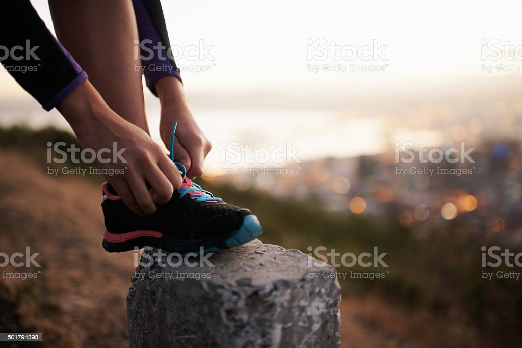 Fastening those laces for a fast-paced fun stock photo