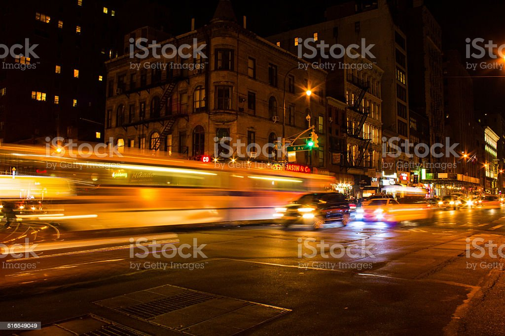 Faster moving bus at night in NYC stock photo