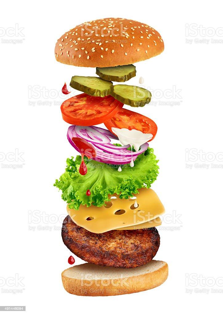 Fastfood - flying ingredients of hamburger. stock photo