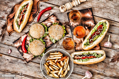 546450250istockphoto Fast-Food, Food Festival. Food Buffet Catering Dining Eating Party Sharing Concept. Food Festival. All kinds of fast food. hot dogs, hamburgers, traditional American food. fast food, Oktoberfest, 878859986