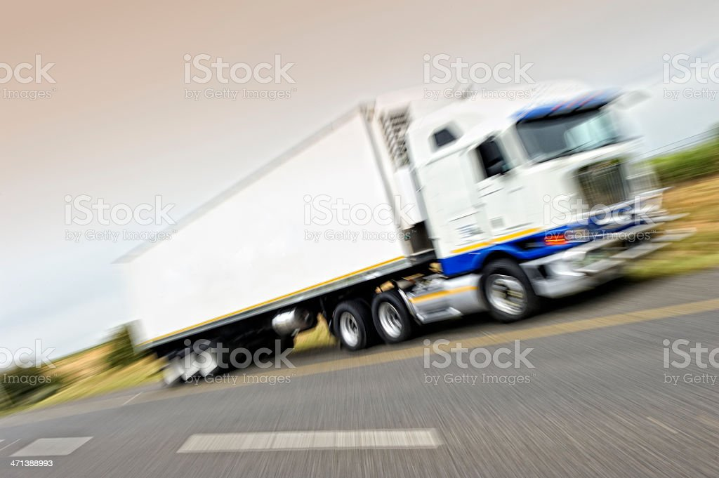 Fast-moving truck on road stock photo