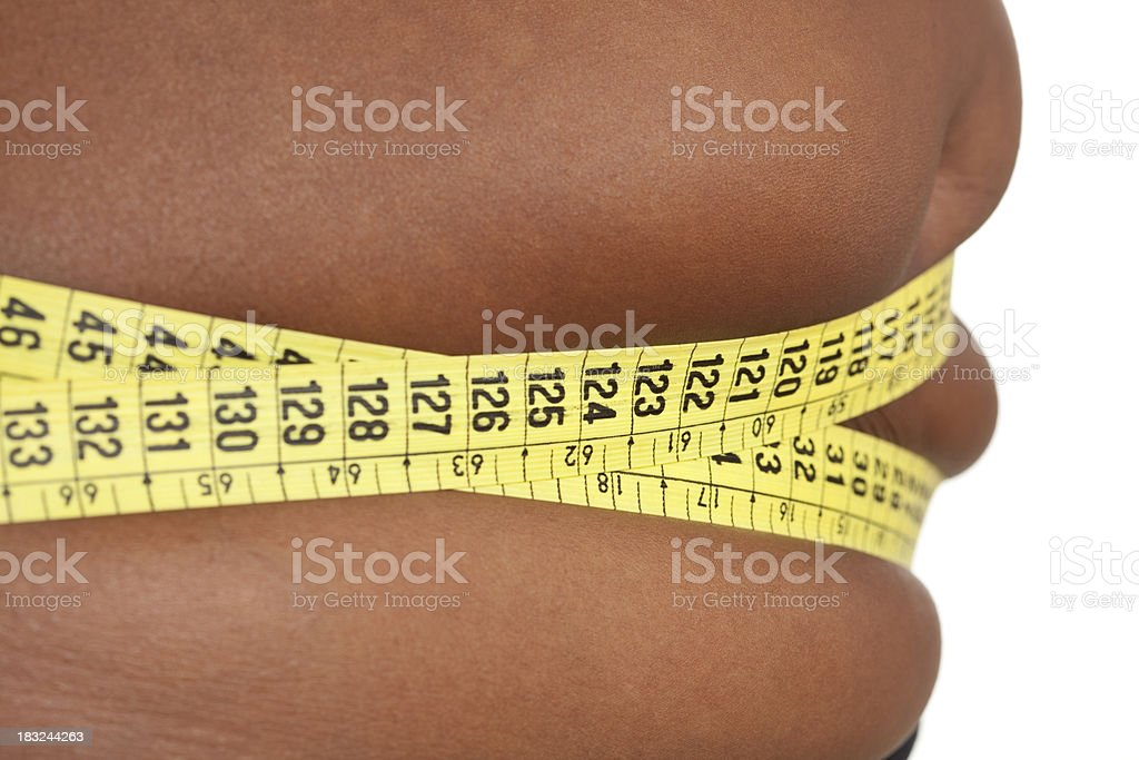 Fat belly measuring. royalty-free stock photo