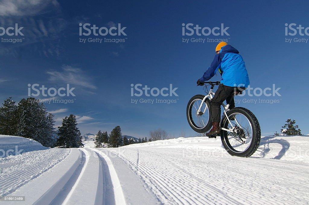 Fat bike Wheelie on Nordic Ski Trail stock photo