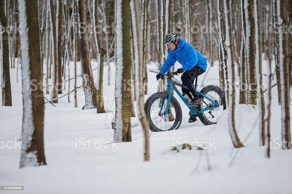 Fat biker riding in the snow stock photo