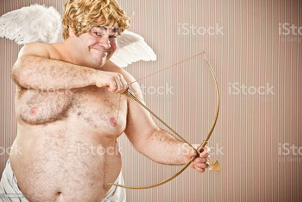 fat blonde cupid with bow and arrow aim for love stock photo