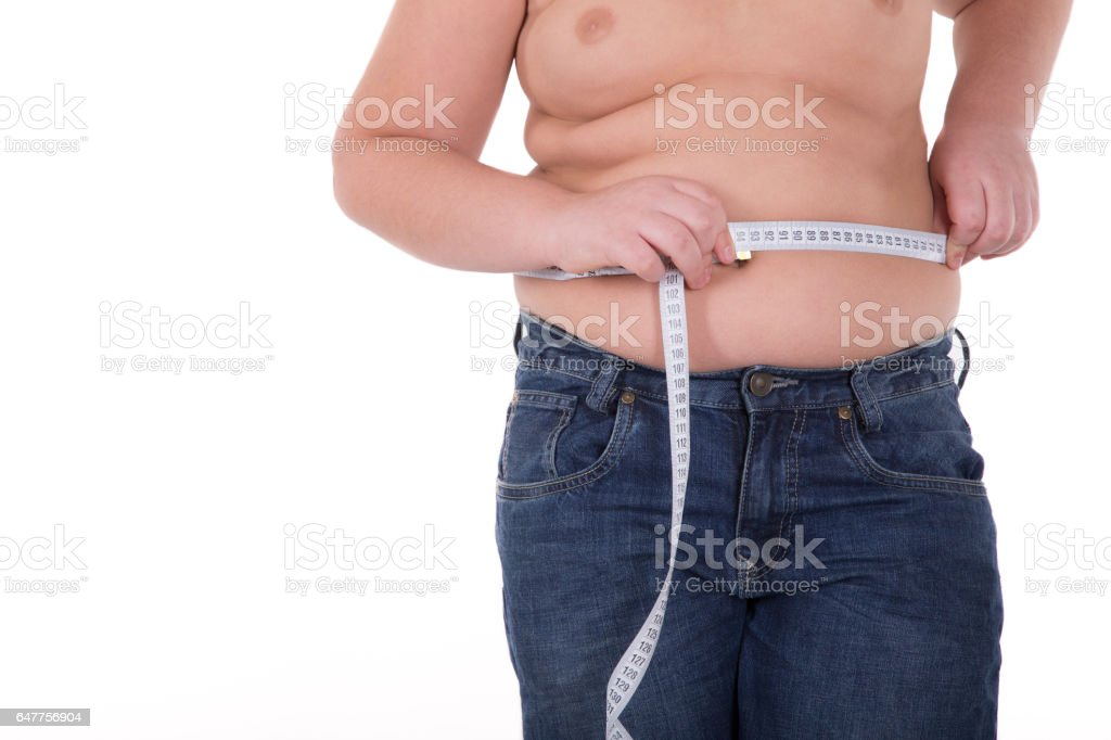 Fat boy measuring his belly stock photo