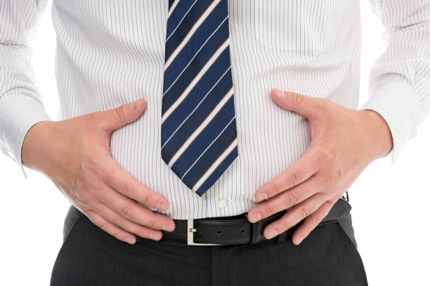 fat businessman's stomach - metabolic syndrome stock photos and pictures