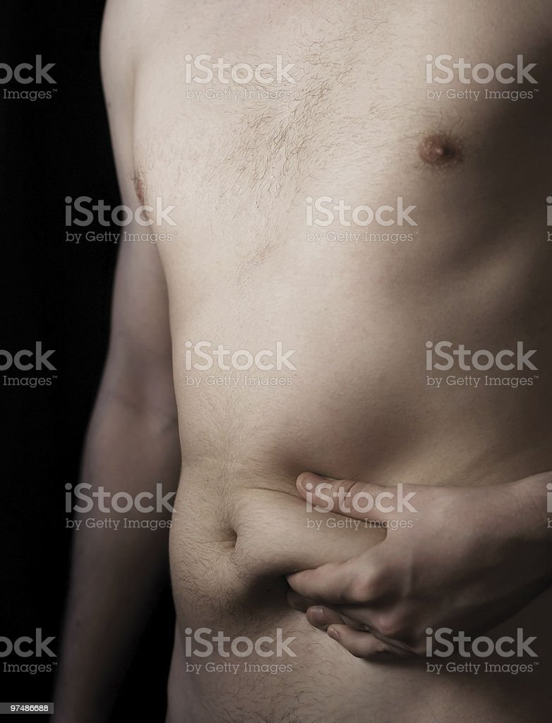 Fat deposit on stomach royalty-free stock photo