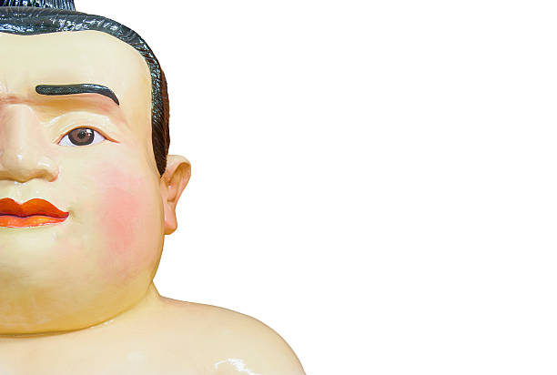fat face sumo doll isolated on white background - sumo stock-fotos und bilder