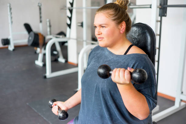 fat girl in a gym - beautiful curvy girls stock photos and pictures