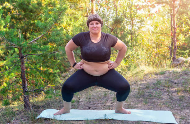 Fat girl wants to lose weight. An obese woman does sports. The girl with excess weight. stock photo