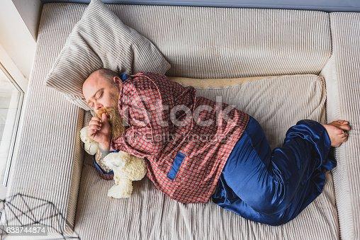 istock Fat guy sleeping on sofa 638744874