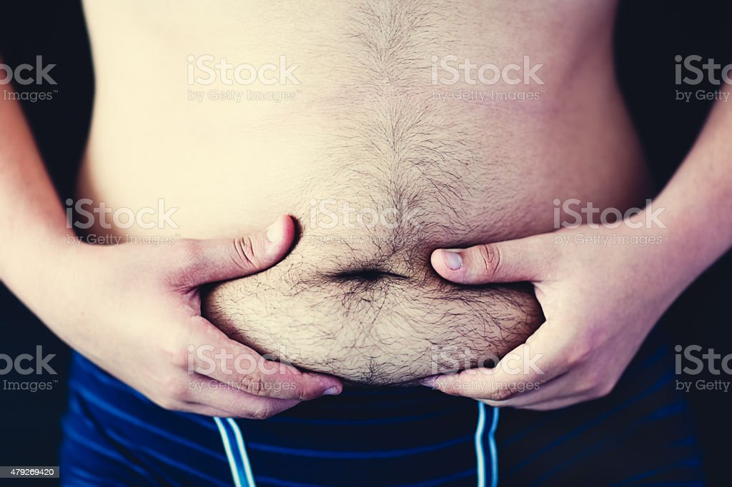 Fat hairy belly stock photo