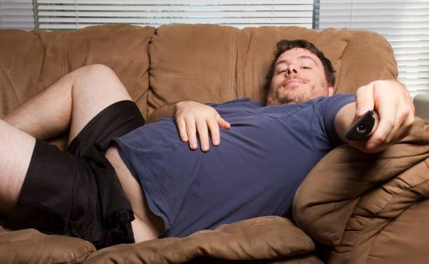 fat lazy man stock photo