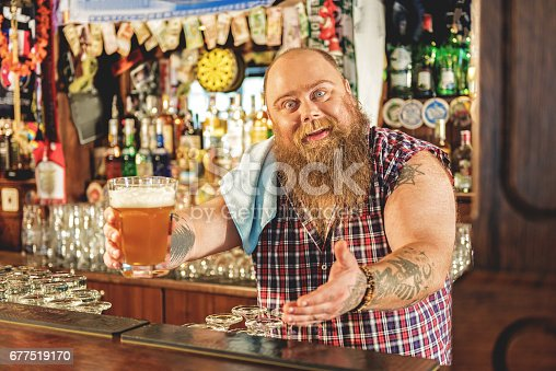istock Fat male giving glass of beer 677519170
