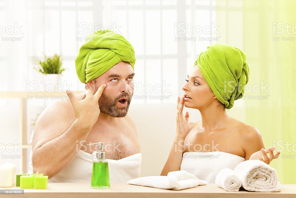 fat man and beautiful girl health care secrets  at spa royalty-free stock photo
