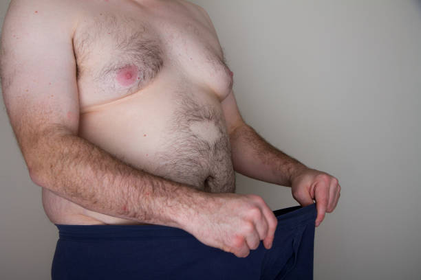 Fat man and his penis stock photo
