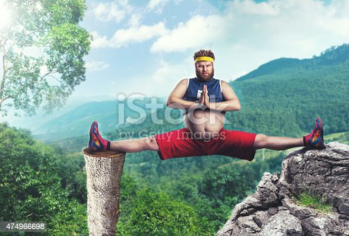 istock Fat man does the splits 474966698