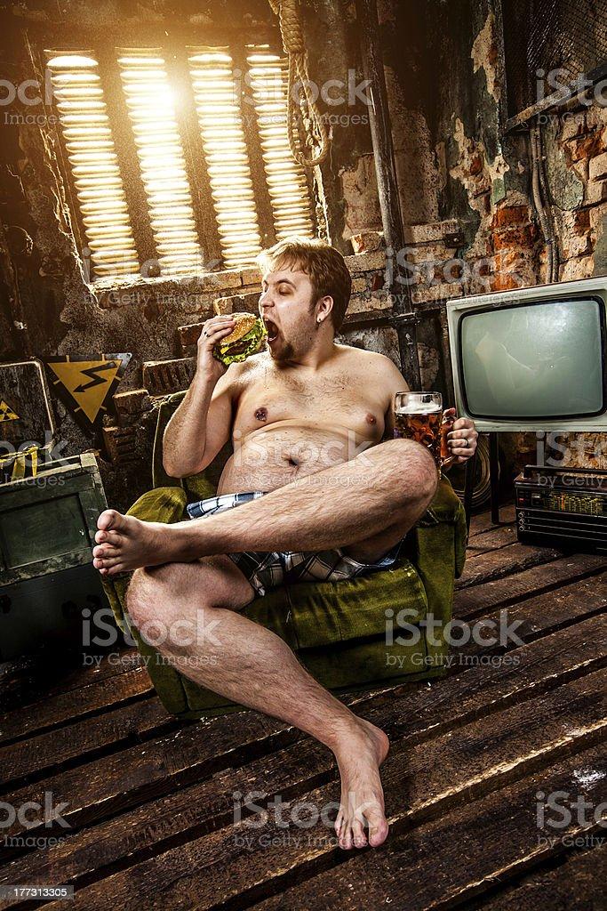 fat man eating hamburger royalty-free stock photo