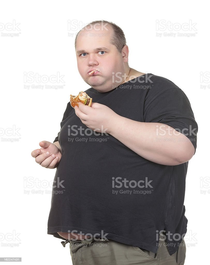 Fat Man Greedily Eating Hamburger royalty-free stock photo