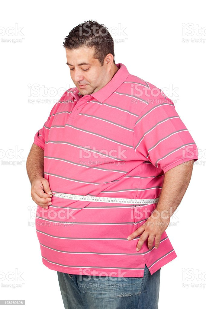 Fat man measuring waistline with tape measure stock photo