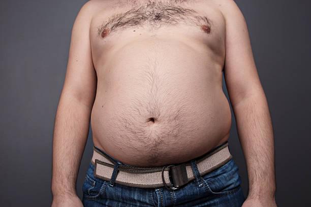 fat man - torso fotografías e imágenes de stock