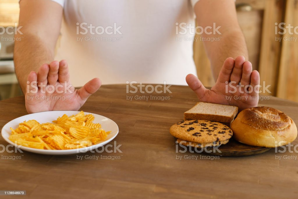 fat man refuse to eat carbs and junk food, diet stock photo