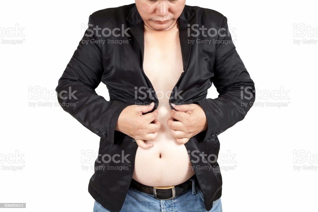 Fat man trying to button his suitston the big belly. stock photo