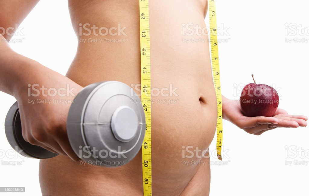 Fat nude woman body holding apple and weight royalty-free stock photo