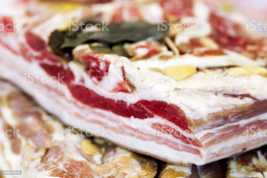 Fat pork with garlic and bay leaves large chunks closeup horizontal background stock photo