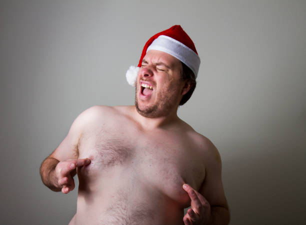 fat santa - naked santa claus stock pictures, royalty-free photos & images