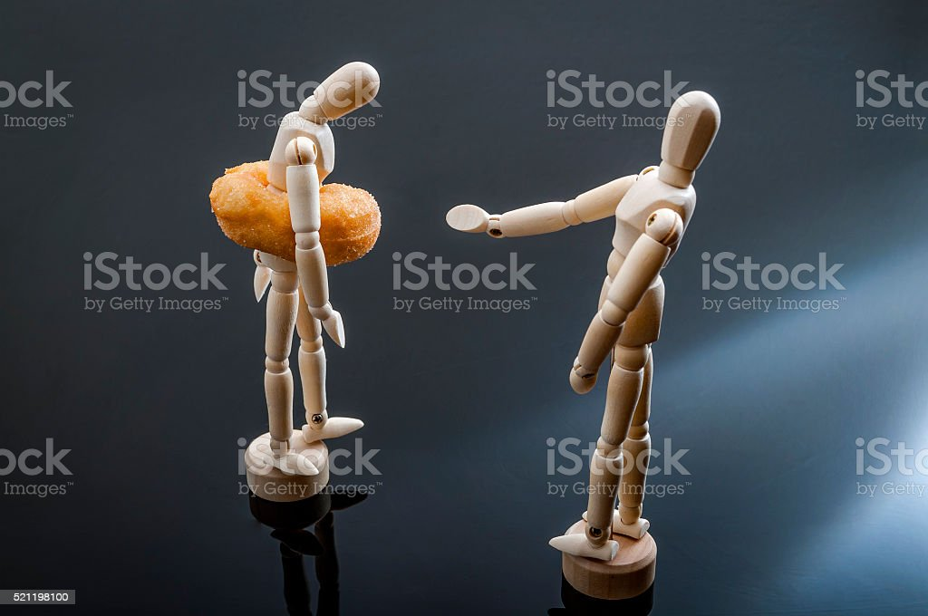 Fat shaming illustrated with figurines stock photo