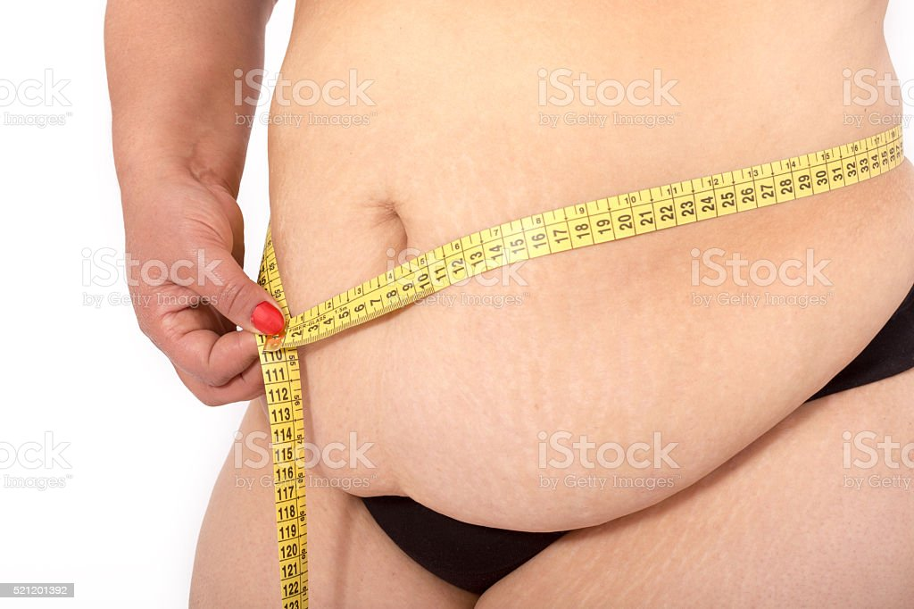 Fat woman holding a measurement tape stock photo