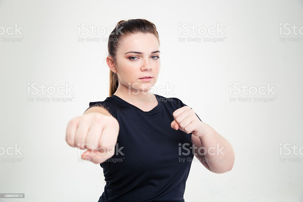 Fat woman in sports wear hitting at camera stock photo