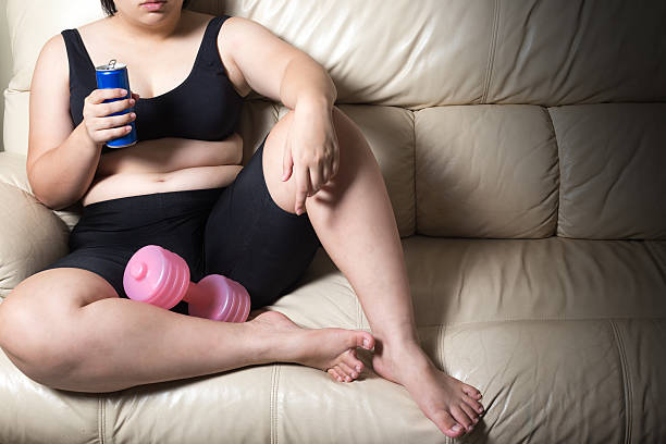 fat woman tired give up exercise concept soft drink - bh träger stock-fotos und bilder