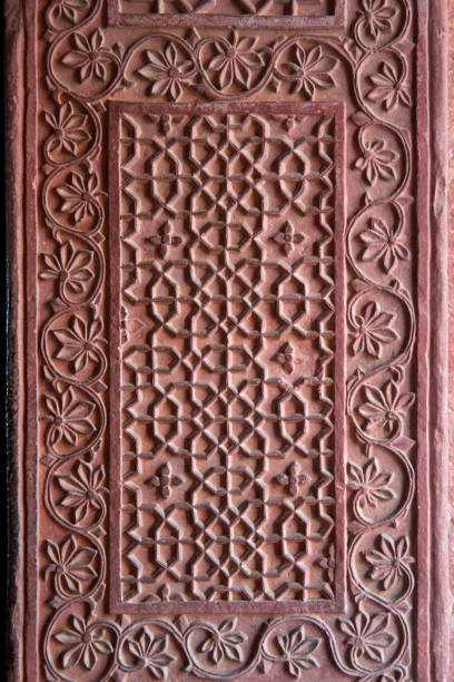 Fatehpur Sikri, Agra, India. Agra, Uttar Pradesh / India - February 7, 2012 : A beautifully carved wall at the Birbal's palace in the courtyard of the Jodhabai's palace in Fatehpur Sikri, Agra. jodha bai's palace stock pictures, royalty-free photos & images