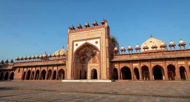 Fatehpur Sikri Jama Masjid mosque - a classic red sandstone architecture of Medieval India. Fatehpur Sikri is a beautifully crafted red sandstone fort city and a classic example of Mughal architecture in India. A UNESCO World Heritage site at Agra, Uttar Pradesh, India. agra jama masjid mosque stock pictures, royalty-free photos & images