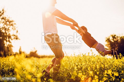 istock Father and baby boy having fun at the field 477881398