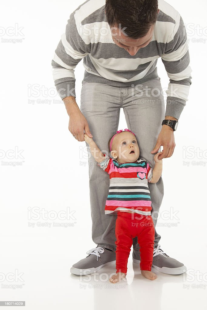 Father and Baby Daughter on a White Background. royalty-free stock photo